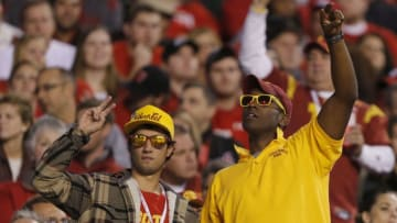 SALT LAKE CITY, UT - OCTOBER 4: Fans of the USC Trojans cheers during a game against the Utah Ute's during the first half of a college football game on October 4, 2012 at Rice-Eccles Stadium in Salt Lake City, Utah. (Photo by George Frey/Getty Images)