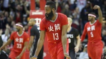 Feb 23, 2015; Houston, TX, USA; Houston Rockets guard James Harden (13) and teammates celebrate Harden