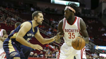 Oct 19, 2015; Houston, TX, USA; Houston Rockets forward Montrezl Harrell (35) drives the ball during the first quarter as New Orleans Pelicans forward Ryan Anderson (33) defends at Toyota Center. Mandatory Credit: Troy Taormina-USA TODAY Sports