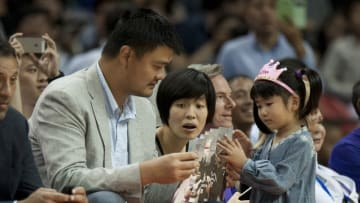 Oct 12, 2014; Shanghai, China; Former Houston Rocket Center Yao Ming watches the Brooklyn Nets play the Sacramento Kings. His wife Ye Li and daughter Yao Qinlei, whose English name is Amy also watch. The Brooklyn Nets beat the Sacramento Kings 97-95 at Mercedes-Benz Arena. Mandatory Credit: Danny La-USA TODAY Sports