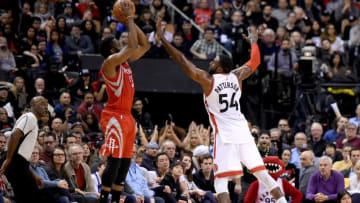 Jan 8, 2017; Toronto, Ontario, CAN; Houston Rockets guard James Harden (13) takes a shot as Toronto Raptors forward Patrick Patterson (54) defends during the second half at Air Canada Centre. Mandatory Credit: Dan Hamilton-USA TODAY Sports