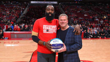 James Harden #13 and owner Tilman Fertitta of the Houston Rockets (Photo by Bill Baptist/NBAE via Getty Images)