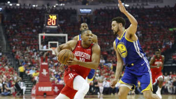Eric Gordon #10 of the Houston Rockets drives to the basket defended by Klay Thompson #11 of the Golden State Warriors (Photo by Tim Warner/Getty Images)