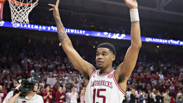 FAYETTEVILLE, AR - MARCH 4: Mason Jones #15 of the Arkansas Razorbacks gets the crowd cheering during a game against the LSU Tigers at Bud Walton Arena on March 4, 2020 in Fayetteville, Arkansas. The Razorbacks defeated the Tigers 99-90. (Photo by Wesley Hitt/Getty Images)