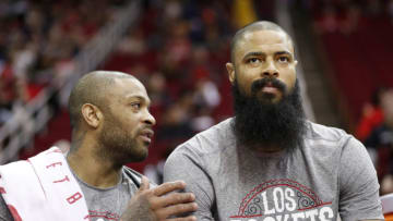 P.J. Tucker #17 of the Houston Rockets talks with Tyson Chandler #19 (Photo by Tim Warner/Getty Images)