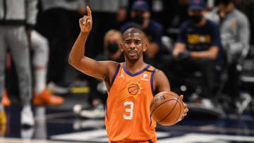 DENVER, CO - JUNE 11: Chris Paul #3 of the Phoenix Suns directs the offense in the first half in Game Three of the Western Conference second-round playoff series at Ball Arena on June 11, 2021 in Denver, Colorado. NOTE TO USER: User expressly acknowledges and agrees that, by downloading and or using this photograph, User is consenting to the terms and conditions of the Getty Images License Agreement. (Photo by Dustin Bradford/Getty Images)