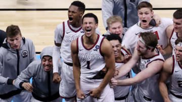INDIANAPOLIS, INDIANA - APRIL 03: Jalen Suggs #1 of the Gonzaga Bulldogs celebrates with teammates after making a game-winning three point basket in overtime to defeat the UCLA Bruins 93-90 during the 2021 NCAA Final Four semifinal at Lucas Oil Stadium on April 03, 2021 in Indianapolis, Indiana. (Photo by Andy Lyons/Getty Images)