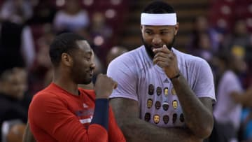 John Wall #2 of the Washington Wizards talks with DeMarcus Cousins #15 of the Sacramento Kings (Photo by Thearon W. Henderson/Getty Images)