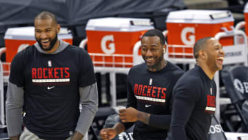 DeMarcus Cousins #15 of the Houston Rockets, John Wall #1, and Eric Gordon #10 (Photo by Ronald Cortes/Getty Images)