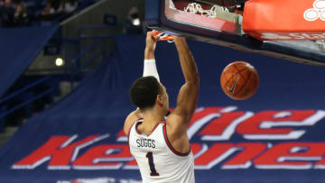 SPOKANE, WASHINGTON - FEBRUARY 27: Jalen Suggs #1 of the Gonzaga Bulldogs catches an alley-oop from teammate Joel Ayayi #11 and dunks the ball in the first half against the Loyola Marymount Lions at McCarthey Athletic Center on February 27, 2021 in Spokane, Washington. (Photo by William Mancebo/Getty Images)