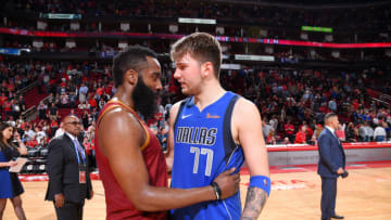 Luka Doncic #77 of the Dallas Mavericks and James Harden #13 of the Houston Rockets (Photo by Bill Baptist/NBAE via Getty Images)