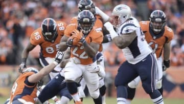 Jan 24, 2016; Denver, CO, USA; Denver Broncos running back C.J. Anderson (22) runs during the second half in the AFC Championship football game at Sports Authority Field at Mile High. Mandatory Credit: Ron Chenoy-USA TODAY Sports