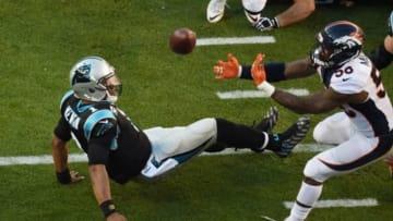 Feb 7, 2016; Santa Clara, CA, USA; Denver Broncos outside linebacker Von Miller (58) strips the ball from Carolina Panthers quarterback Cam Newton (1) in Super Bowl 50 at Levi