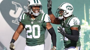 Nov 8, 2015; East Rutherford, NJ, USA; New York Jets strong safety Marcus Williams (20) celebrates with free safety Marcus Gilchrist (21) during the NFL game at MetLife Stadium. The Jets won, 28-23. Mandatory Credit: Vincent Carchietta-USA TODAY Sports