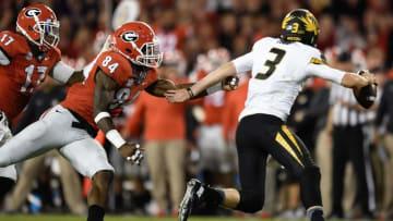 Oct 17, 2015; Athens, GA, USA; Georgia Bulldogs linebacker Leonard Floyd (84) chases Missouri Tigers quarterback Drew Lock (3) during the second half at Sanford Stadium. Georgia defeated Missouri 9-6. Mandatory Credit: Dale Zanine-USA TODAY Sports