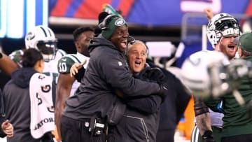 Dec 6, 2015; East Rutherford, NJ, USA; New York Jets head coach Todd Bowles (left) celebrates after New York Giants kicker Josh Brown (not pictured) misses a field goal during overtime at MetLife Stadium. The Jets defeated the Giants 23-20 in overtime. Mandatory Credit: Brad Penner-USA TODAY Sports