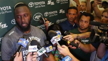 Jul 30, 2015; Florham Park, NJ, USA; New York Jets defensive end Muhammad Wilkerson (96) answers questions about his contract from the media during first day of training camp at Atlantic Health Jets Training Center. Mandatory Credit: Noah K. Murray-USA TODAY Sports