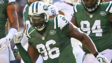 Nov 29, 2015; East Rutherford, NJ, USA; New York Jets defensive end Muhammad Wilkerson (96) celebrates his sack of Miami Dolphins quarterback Ryan Tannehill (17)(not shown) during the first half at MetLife Stadium. Mandatory Credit: Ed Mulholland-USA TODAY Sports