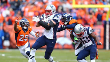 Jan 24, 2016; Denver, CO, USA; New England Patriots tight end Rob Gronkowski (87) runs past Denver Broncos cornerback Chris Harris (25) in the third quarter in the AFC Championship football game at Sports Authority Field at Mile High. Mandatory Credit: Mark J. Rebilas-USA TODAY Sports