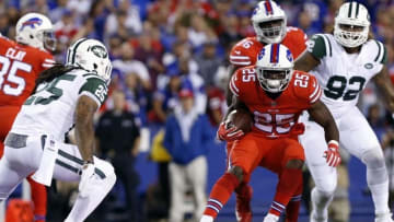 Sep 15, 2016; Orchard Park, NY, USA; Buffalo Bills running back LeSean McCoy (25) runs with the ball as New York Jets strong safety Calvin Pryor (25) pursues during the first half at New Era Field. Mandatory Credit: Kevin Hoffman-USA TODAY Sports
