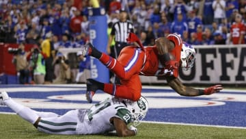 Sep 15, 2016; Orchard Park, NY, USA; Buffalo Bills running back Mike Gillislee (35) dives for a touchdown as New York Jets free safety Marcus Gilchrist (21) tries to tackle him during the second half at New Era Field. The Jets beat the Bills 37-31. Mandatory Credit: Kevin Hoffman-USA TODAY Sports