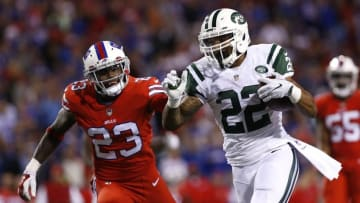Sep 15, 2016; Orchard Park, NY, USA; New York Jets running back Matt Forte (22) runs for a touchdown as Buffalo Bills strong safety Aaron Williams (23) pursues during the second half at New Era Field. The Jets beat the Bills 37-31. Mandatory Credit: Kevin Hoffman-USA TODAY Sports