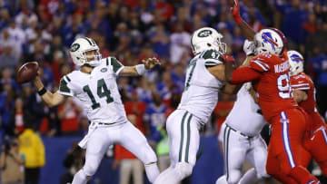 Sep 15, 2016; Orchard Park, NY, USA; New York Jets quarterback Ryan Fitzpatrick (14) throws a pass as Buffalo Bills defensive tackle Adolphus Washington (92) rushes during the second half at New Era Field. The Jets beat the Bills 37-31. Mandatory Credit: Kevin Hoffman-USA TODAY Sports