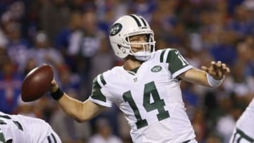 Sep 15, 2016; Orchard Park, NY, USA; New York Jets quarterback Ryan Fitzpatrick (14) throws a pass during the second half against the Buffalo Bills at New Era Field. The Jets beat the Bills 37-31. Mandatory Credit: Timothy T. Ludwig-USA TODAY Sports