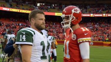 Sep 25, 2016; Kansas City, MO, USA; New York Jets quarterback Ryan Fitzpatrick (14) talks to Kansas City Chiefs quarterback Alex Smith (11) after their game at Arrowhead Stadium. Kansas City won 24-3. Mandatory Credit: John Rieger-USA TODAY Sports