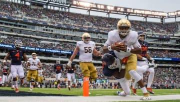 Oct 1, 2016; East Rutherford, NJ, USA; Notre Dame Fighting Irish quarterback DeShone Kizer (14) is tackled by Syracuse Orange cornerback Corey Winfield (11) in the first quarter at MetLife Stadium. Mandatory Credit: Matt Cashore-USA TODAY Sports