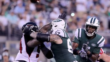 EAST RUTHERFORD, NJ - AUGUST 10: Teddy Bridgewater #5 of the New York Jets passes the ball as Deadrin Senat #94 of the Atlanta Falcons and Obum Gwacham #57 of the New York Jets fight for position during a preseason game at MetLife Stadium on August 10, 2018 in East Rutherford, New Jersey. (Photo by Elsa/Getty Images)