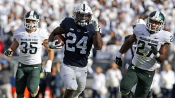 STATE COLLEGE, PA - OCTOBER 13: Miles Sanders #24 of the Penn State Nittany Lions rushes for 78 yards against Joe Bachie #35 of the Michigan State Spartans and Khari Willis #27 of the Michigan State Spartans on October 13, 2018 at Beaver Stadium in State College, Pennsylvania. (Photo by Justin K. Aller/Getty Images)