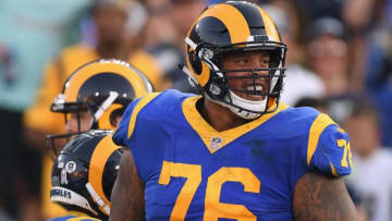 LOS ANGELES, CA - NOVEMBER 11: Rodger Saffold #76 of the Los Angeles Rams celebrates a touchdown during the game against the Seattle Seahawks at Los Angeles Memorial Coliseum on November 11, 2018 in Los Angeles, California. (Photo by Harry How/Getty Images)
