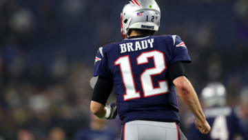 FOXBOROUGH, MASSACHUSETTS - JANUARY 04: Tom Brady #12 of the New England Patriots runs towards the bench before the AFC Wild Card Playoff game against the Tennessee Titans at Gillette Stadium on January 04, 2020 in Foxborough, Massachusetts. (Photo by Maddie Meyer/Getty Images)