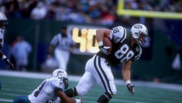 4 Oct 1998: Tight end Kyle Brady #88 of the New York Jets in action against safety Brock Marion #31 of the Miami Dolphins during a game at the Giants Stadium in East Rutherford, New Jersey. The Jets defeated the Dolphins 20-9.