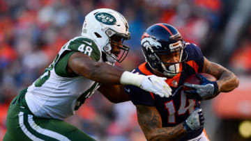 DENVER, CO - DECEMBER 10: Wide receiver Cody Latimer #14 of the Denver Broncos is hit by outside linebacker Jordan Jenkins #48 of the New York Jets after a catch in the third quarter of a game at Sports Authority Field at Mile High on December 10, 2017 in Denver, Colorado. (Photo by Dustin Bradford/Getty Images)