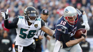 FOXBOROUGH, MA - JANUARY 21: Tom Brady #12 of the New England Patriots is pursued by Dante Fowler Jr. #56 of the Jacksonville Jaguars in the first quarter during the AFC Championship Game at Gillette Stadium on January 21, 2018 in Foxborough, Massachusetts. (Photo by Elsa/Getty Images)