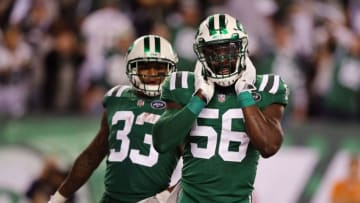 EAST RUTHERFORD, NJ - NOVEMBER 02: Inside linebacker Demario Davis #56 of the New York Jets celebrates alongside teammate strong safety Jamal Adams #33 against the Buffalo Bills during the third quarter of the game at MetLife Stadium on November 2, 2017 in East Rutherford, New Jersey. (Photo by Elsa/Getty Images)