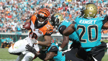 JACKSONVILLE, FL - NOVEMBER 05: Joe Mixon #28 of the Cincinnati Bengals runs for a 7-yard touchdown against the Jacksonville Jaguars in the first half of their game at EverBank Field on November 5, 2017 in Jacksonville, Florida. (Photo by Sam Greenwood/Getty Images)