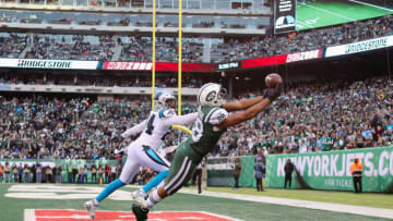 EAST RUTHERFORD, NJ - NOVEMBER 26: Tight end Austin Seferian-Jenkins #88 of the New York Jets attempts to make a catch against cornerback James Bradberry #24 of the Carolina Panthers during the fourth quarter of the game at MetLife Stadium on November 26, 2017 in East Rutherford, New Jersey. The play was originally called a touchdown, but was reviewed, ruled as an incomplete pass and reversed. (Photo by Abbie Parr/Getty Images)