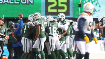 EAST RUTHERFORD, NJ - DECEMBER 24: The New York Jets celebrate after recovering an on-side kick on the opening play of the game during the first half against the Los Angeles Chargers in an NFL game at MetLife Stadium on December 24, 2017 in East Rutherford, New Jersey. (Photo by Ed Mulholland/Getty Images)