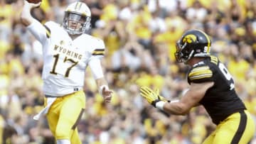 IOWA CITY, IOWA- SEPTEMBER 2: Quarterback Josh Allen #17 of the Wyoming Cowboys throws pass in front of defensive end Matt Nelson #96 of the Iowa Hawkeyes during the second quarter, on September 2, 2017 at Kinnick Stadium in Iowa City, Iowa. (Photo by Matthew Holst/Getty Images)