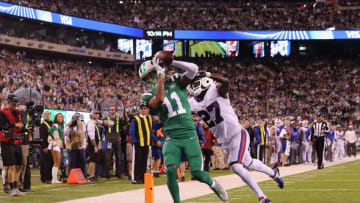 EAST RUTHERFORD, NJ - NOVEMBER 02: Wide receiver Robby Anderson #11 of the New York Jets makes a touchdown catch against cornerback Tre'Davious White #27 of the Buffalo Bills during the third quarter of the game at MetLife Stadium on November 2, 2017 in East Rutherford, New Jersey. (Photo by Elsa/Getty Images)