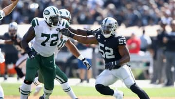 OAKLAND, CA - SEPTEMBER 17: Khalil Mack #52 of the Oakland Raiders matches up against Brandon Shell #72 of the New York Jets at Oakland-Alameda County Coliseum on September 17, 2017 in Oakland, California. (Photo by Ezra Shaw/Getty Images)