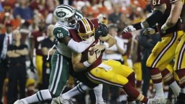 LANDOVER, MD - AUGUST 16: Linebacker Jordan Jenkins #48 of the New York Jets sacks quarterback Colt McCoy #12 of the Washington Redskins in the first quarter of a preseason game at FedExField on August 16, 2018 in Landover, Maryland. (Photo by Patrick McDermott/Getty Images)