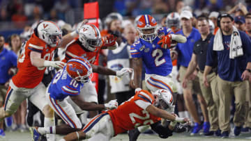 MIAMI GARDENS, FL - DECEMBER 30: Joey Blount #29 of the Virginia Cavaliers tackles Lamical Perine #2 of the Florida Gators as he runs its the ball at the Capital One Orange Bowl at Hard Rock Stadium on December 30, 2019 in Miami Gardens, Florida. Florida defeated Virginia 36-28. (Photo by Joel Auerbach/Getty Images)