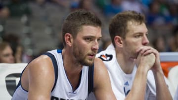Mar 7, 2016; Dallas, TX, USA; Dallas Mavericks forward Chandler Parsons (25) and forward David Lee (42) watch from the bench during the second half against the Los Angeles Clippers at the American Airlines Center. The Clippers defeat the Mavericks 109-90. Mandatory Credit: Jerome Miron-USA TODAY Sports