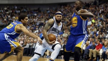 Mar 18, 2016; Dallas, TX, USA; Dallas Mavericks guard Deron Williams (8) drives on Golden State Warriors forward James Michael McAdoo (20) and forward Draymond Green (23) in the second quarter at American Airlines Center. Mandatory Credit: Tim Heitman-USA TODAY Sports