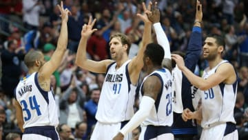 Mar 20, 2016; Dallas, TX, USA; Dallas Mavericks forward Dirk Nowitzki (41) celebrates with teammates after scoring a three point basket in overtime against the Portland Trail Blazers at American Airlines Center. The Mavs beat the Trail Blazers 132-120. Mandatory Credit: Matthew Emmons-USA TODAY Sports