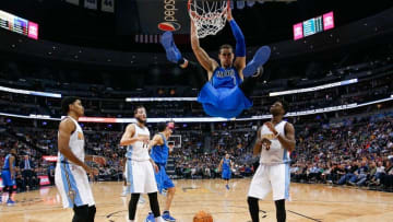 Mar 28, 2016; Denver, CO, USA; Dallas Mavericks forward Dwight Powell (7) dunks the ball against Denver Nuggets guard Gary Harris (14) and center Joffrey Lauvergne (77) and guard JaKarr Sampson (9) in the fourth quarter at the Pepsi Center. The Mavericks defeated the Nuggets 97-88. Mandatory Credit: Isaiah J. Downing-USA TODAY Sports